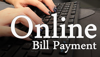 Online Bill Pay image with hands on keyboard